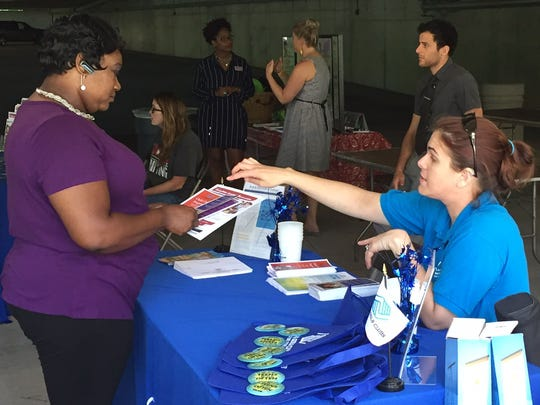 Hanan Parker (left) talks with Morgan Barnes with the Boys and Girls Club of Delaware during the United Way of Delaware's Do More 24 event Thursday morning in Brandywine Hundred.