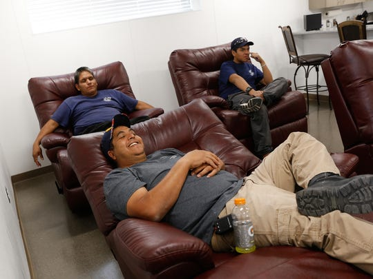 Valley Fire Department Station 1 firefighters Eric Trevizo, front, and Leo Tsinnie, left, relax in their newly renovated lounge area Friday at the station in Kirtland.
