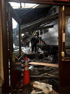 A NJ Transit train seen through the wreckage after it crashed into the platform at the Hoboken Terminal on Thursday.