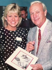 At the 1989 U.S. Open at Oak Hill Country Club, Arnold Palmer signed a copy of a photo from 1968 of him giving an autograph to Holly Geoghegan.