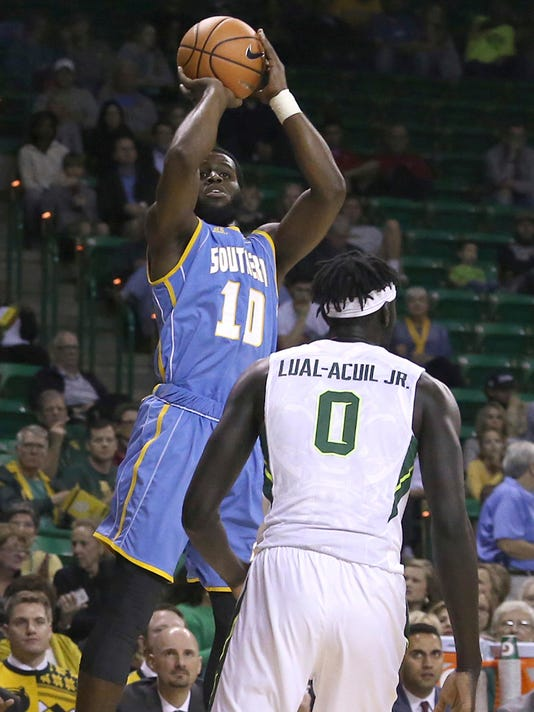 Southern University guard Jamar Sandifer (10) shoots over Baylor forward Jo Lual-Acuil Jr. (0) during the first half of an NCAA college basketball game Wednesday, Dec. 20, 2017, in Waco, Texas. (AP Photo/Jerry Larson)