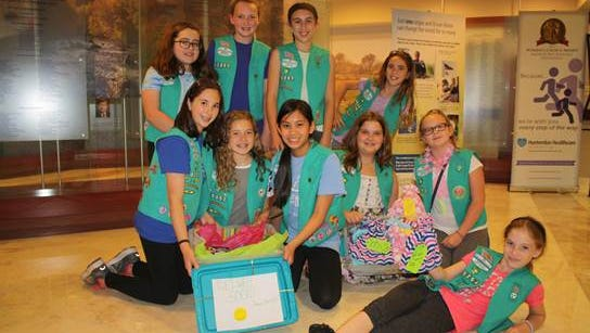 Girl Scout Troop 80357 from Delaware Township donated cards, toys and handmade hats to the Hunterdon Medical Center Pediatric Unit. The troop purchased the items using money they earned from selling cookies. The project was done to earn their Bronze Award. From left: (back row) Paige Lubold, Erin Church, Kiera Yarrow, Lizzie Gillespie; (front row) Samantha Whiteman, Amanda Walker, Madeline Rivera, Jayla Prassl, Katherine Shearer andAnna Nagy.