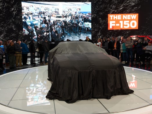 The crowd waits for the unveiling of the 2018 Ford