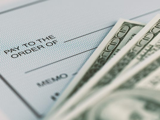 Personal Check and American Dollars With Selective Focus