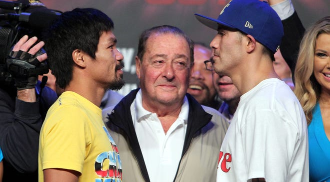 Manny Pacquiao and Brandon Rios weigh in ( Pacquiao 145 lbs, Rios 146.5 lbs) at The Venetian Macao Resort in Macau, China on Friday, as promoter Bob Arum looks on.