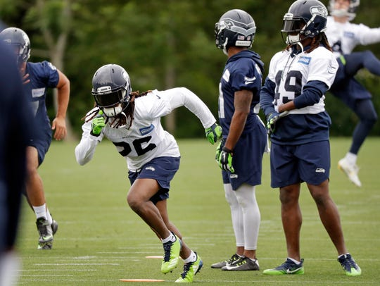 Seahawks cornerback Shaquill Griffin, left, starts