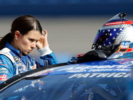 Danica Patrick prepares for the qualifying session for the NASCAR Cup Series auto race at Auto Club Speedway in Fontana, Calif., Friday, March 24, 2017. (AP Photo/Alex Gallardo)
