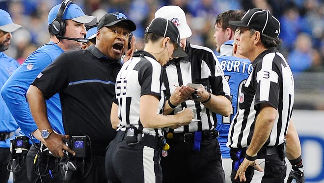 Jim Caldwell argues with officials during the second quarter of the Lions' game against the Bears.