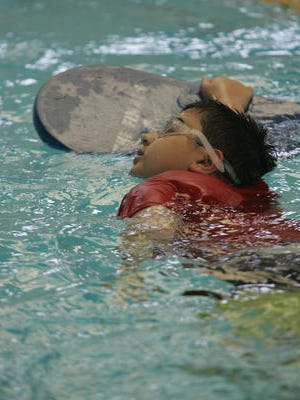 Krish Chandwam, 9, of Monroe Township works on his swimming technique during a Guppy class at the YMCA of Western Monmouth.