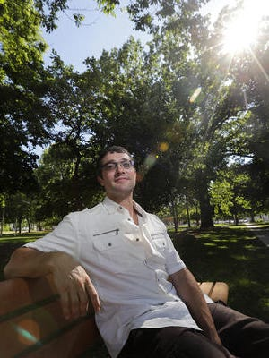 Nathan Lecker relaxes in a Green Bay park on June 8, 2017. Lecker is one of the first graduates of a program designed to help former prison inmates with opioid addictions maintain the sobriety they have worked to achieve.