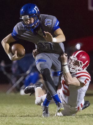 Brophy College Prep senior LB, SS Rex Linthicum (5) sacks Chandler sophomore QB Jacob Conover (17) in the second quarter at Chandler High School on Friday, Oct. 21, 2016.