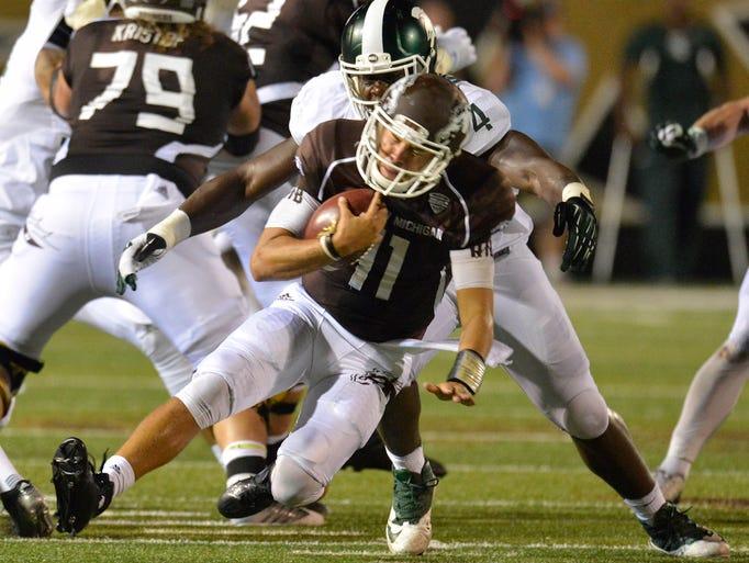 Western Michigan quarterback Zach Terrell closes his