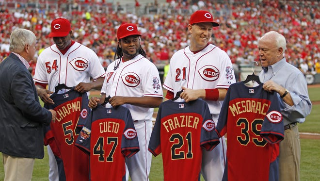 Cincinnati Reds President and CEO Bob Castellini, left, congratulates players selected for the All-Star Game as they receive their jerseys.