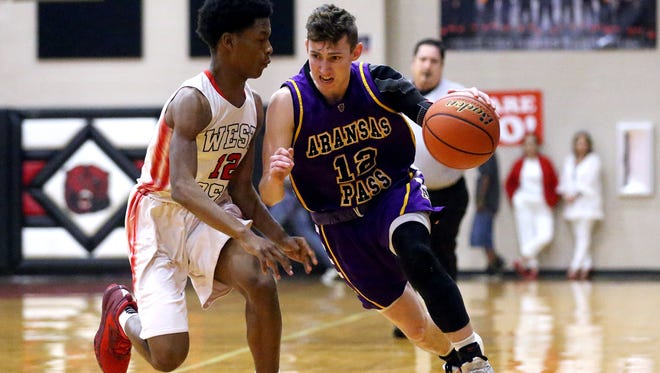 Aransas Pass' Greg Giageos dribbles down the court against gainst West Oso's KeAaron Sanders on Tuesday, Feb. 7, 2017, at West Oso High School in Corpus Christi.