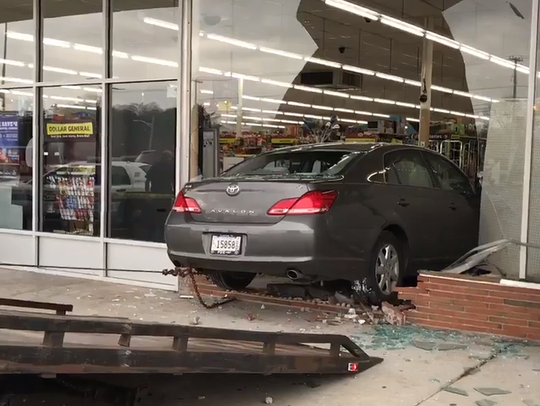 A car crashed through a plate-glass window at a Dollar