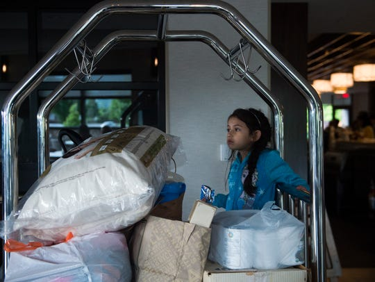Mariel Poole, 5, stands amid donations her and her