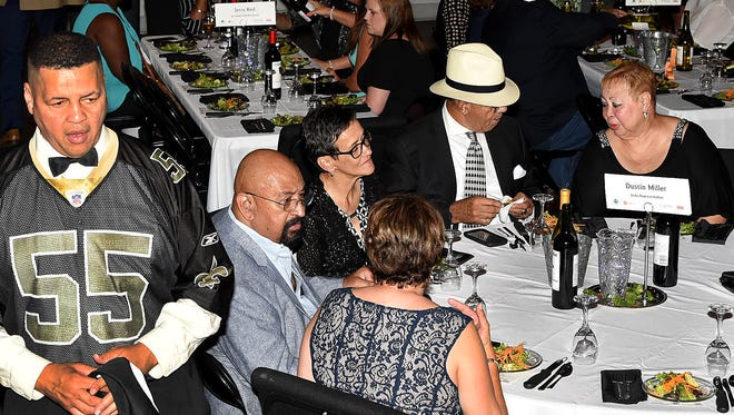 """St. Landry Parish Councilman Dexter Brown keeps a keen eye on his table as he serves as a celebrity waiter at Saturday's """"Men Who Wait on Women Who Wine"""" event at the Delta Grand Theatre. Fun, frivolity and shenanigans were the themes for the very first event, sponsored by Women United, an affinity group of St. Landry-Evangeline United Way. See more photos at dailyworld.com and on the Daily World Facebook page."""