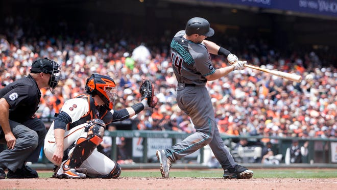Jul 9, 2016: Arizona Diamondbacks first baseman Paul Goldschmidt (44) doubles to left field in front of San Francisco Giants catcher Buster Posey (28) in the fourth inning at AT&T Park.