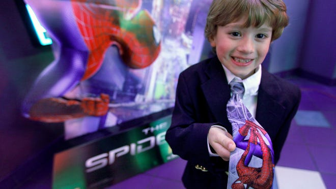 Robbie LaDucca, 8, of Spencerport shows off his tie before the invitation-only screening of  The Amazing Spider-Man 2  at the Regal Henrietta Cinema in Henrietta .