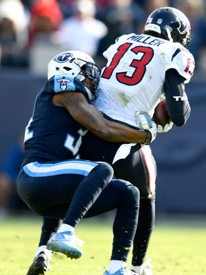 Titans safety Kevin Byard (31) stops Texans wide receiver Braxton Miller (13) during the first half of a game at Nissan Stadium Sunday, Dec. 3, 2017 in Nashville, Tenn.