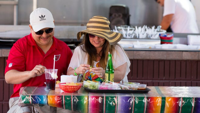 Carlos Aguilar and his wife Estella, of Tucson, enjoy shrimp tacos from Asadero Guss in Puerto Penasco, Mexico.