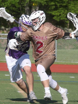 Arlington's Riley Carroll is pressured by Clarkstown North's Santino Crespo during their Section 1 Class A first round boys lacrosse game at Arlington May 17, 2017.
