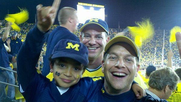 Randy Winograd, front, with his son Patrick, and Les Winograd, rear, are pictured at a Michigan game.