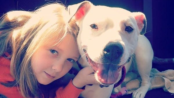 Kadynce Campbell, 10, with Nevada Mae, a pitbull the family rescued in 2014.  Nevada Mae is a sweet Pitbull that rarely leaves Campbell's side said her mother, Tiffany Tyree.