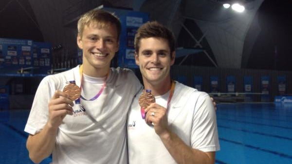 Steele Johnson and David Boudia show off their bronze medals they won Wednesday at the Diving World Cup in China.