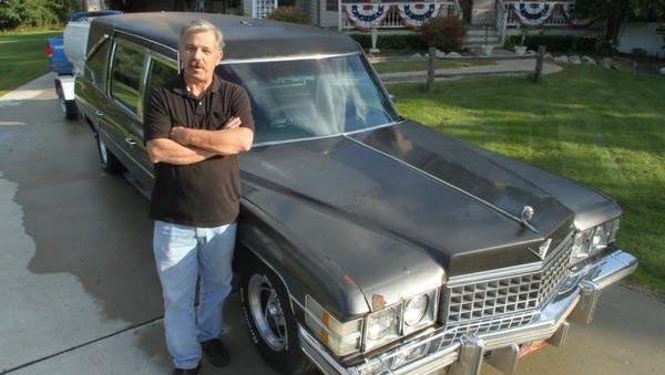 """Club co-founder Frank Hendeen's love of hearses didn't come until after he """"died."""" He suffered a ruptured appendix in 1995 and his heart stopped twice in the hospital. He now owns three Cadillac hearses."""