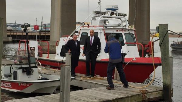 New Jersey's two Democratic U.S. Senators, Robert Menendez, left, and Cory Booker, take a tour of the Secaucus Public Safety Marina before a news conference Friday morning. The pair announced an agreement with the Federal Emergency Management Agency on major changes regarding flood insurance and Superstorm Sandy victims.