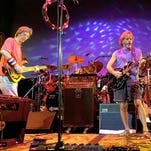 "From left to right, Phil Lesh, Bill Kreutzmann, Bob Weir and Mickey Hart perform during a Grateful Dead reunion concert in 2002 in East Troy, Wisconsin. The band members will perform three ""Fare Thee Well"" shows from July 3-5 at Soldier Field in Chicago."