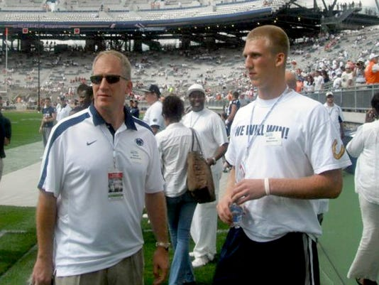 Promising tight end Adam Breneman (shown with his father, Brian, left) said he will continue leading Penn State.
