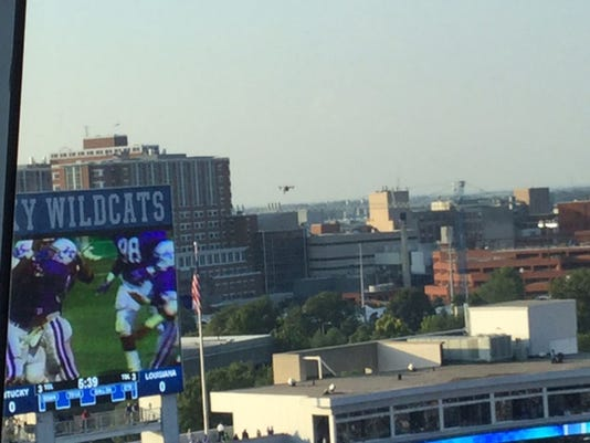 A drone, center, crashed into a part of newly renovated Commonwealth Stadium before the Wildcats faced Louisiana-Lafayette in the season opener, Kentucky officials confirmed Saturday, Sept. 5, 2015. School spokesman Jay Blanton said via email that the unmanned aircraft was recovered near the suite level. He added that there were no injuries to spectators or damages to the facility, which just underwent a $120 million renovation. (John Clay/Lexington Herald-Leader via AP)