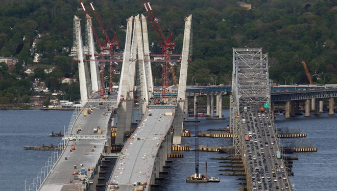Traffic moves on the Tappan Zee Bridge as construction continues on the new bridge May 12, 2017.