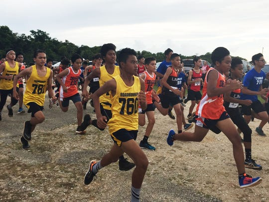Runners kick off the A-team boys race for the Guam Department of Education Interscholastic Middle School All-Island Cross-Country Meet Thursday at Okkodo High School.