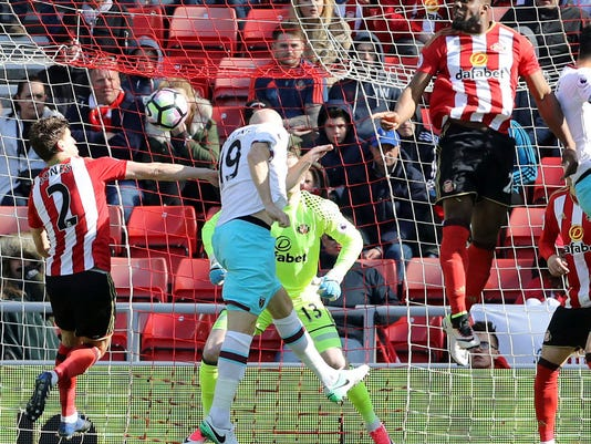 West Ham United's James Collins, centre, scores his side's second goal of the game during the Premier League soccer match between Sunderland and West Ham United at the Stadium of Light, Sunderland, England.  Saturday April 15, 2017. (Owen Humphreys/PA via AP)