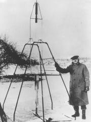 Robert H. Goddard shows off the world's first liquid-propellent rocket at Auburn, Mass., March 16, 1926.