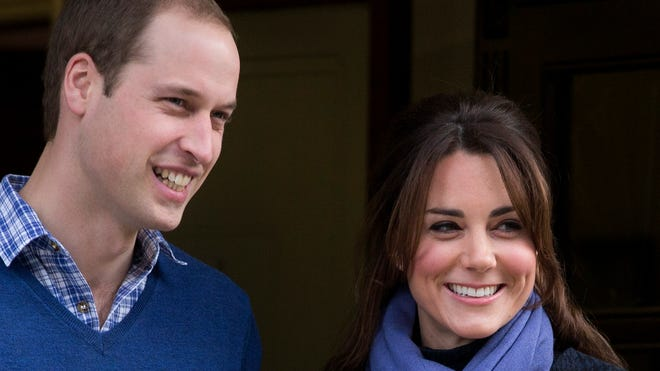 Britain's Prince William stands next to his wife Kate, duchess of Cambridge, in 2012.