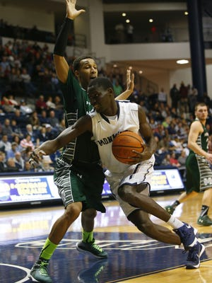 Monmouth Hawks forward Pierre Sarr (1) drives to the basket against Manhattan Jaspers forward Calvin Crawford (14) during the first half at Monmouth University. West Long Branch,NJ. Monday, February 15, 2016. Noah K. Murray/CORRESPONDENT ASB 0216 Monmouth Basketball