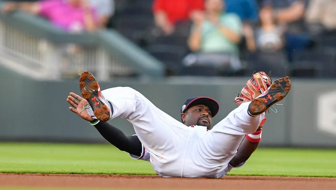 Atlanta Braves second baseman Brandon Phillips (4) lands after making a leaping catch against the New York Mets during the first inning at SunTrust Park on May 1.