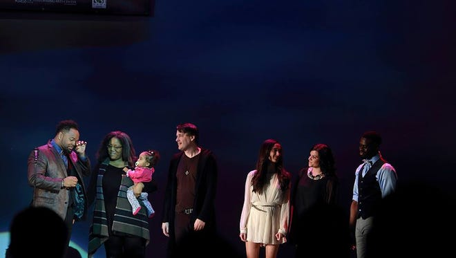 """ICON 2016 Timothy Walton is pictured with his wife, Lauren, their daughter, and fellow """"Fearless ICON"""" finalists (from left) Craig Tiede, Vanessa Sierra, Natasha Kurilew and Kyle Javon."""