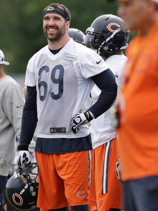 Chicago Bears defensive end Jared Allen (69) smiles as he watches teammates during NFL football training camp at Olivet Nazarene University on Friday, July 25, 2014., in Bourbonnais, Ill. (AP Photo/Nam Y. Huh)