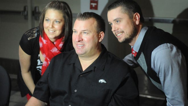 Arkansas head football coach Bret Bielema signed autographs and posed for photographs with fans before speaking to the Baxter County Razorback Club banquet on Tuesday night at the Vada Sheid Community Development Center.