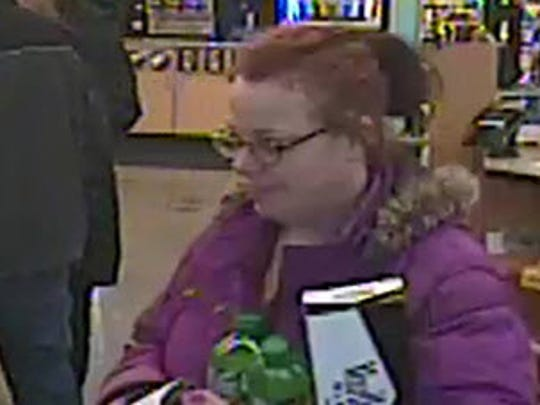 Johnston police are requesting the public's assistance in identifying the woman in this picture in relation to a fraud case.