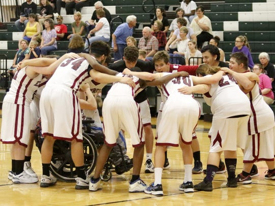 Elmira players huddle together before a Unified Sports