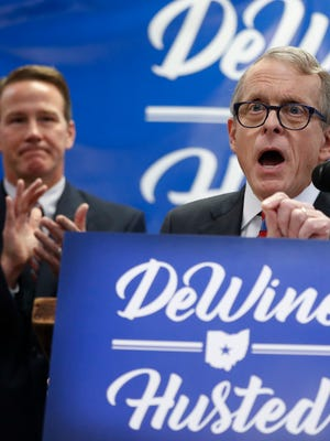 Ohio Attorney General Mike DeWine, right.