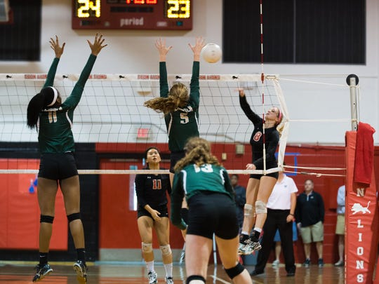Leon senior Ashley Dodson goes for a kill during a 3-1 regional semifinal win over Lincoln. Dodson had 12 kills and nine digs in the match.