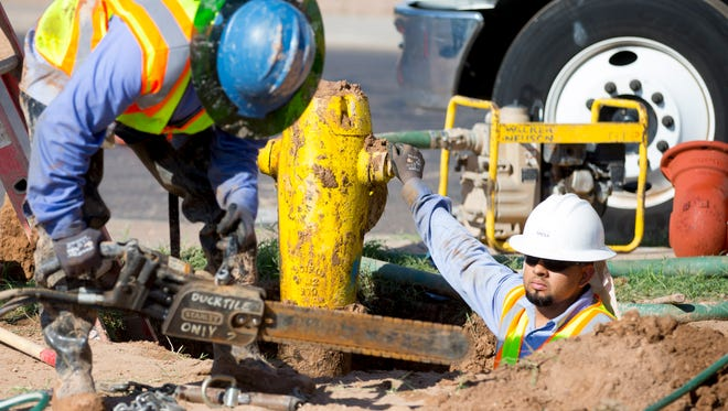 A city crew replaces a leaky fire hydrant. Mesa is asking for $580 million to improve infrastructure.