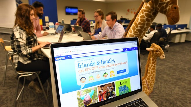 The Toys R Us Web team in Wayne, N.J., works April 25, 2017, on a revamped website making its debut May 8, 2017. The makeover will feature bolder images, streamlined menus, and a pared down check out process.